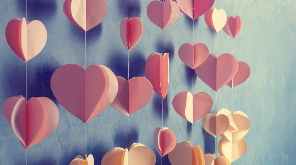 Paper craft hearts hanging on a wall